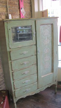 love this, and the way it was repurposed! Repurposed Vintage 1930's Dresser or Wardrobe Distressed, Handpainted Art, and Vintage Hardware. $500.00, via Etsy.