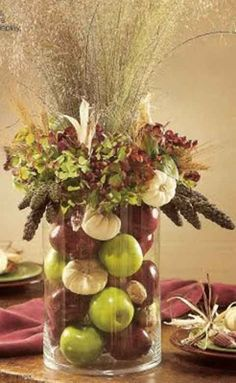 Autumn arrangement (Pinspiration – omit flowers on top; inside vase: apples, ti… Autumn arrangement (Pinspiration – omit flowers on top; inside vase: apples, tiny gourds, walnuts in the shell, small dried Indian corn) Bountiful Harvest, Fall Harvest, Thanksgiving Decorations, Seasonal Decor, Thanksgiving Tablescapes, Seasonal Fruits, Apple Decorations, Ikebana, Deco Floral