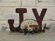 This primitive Joy lettering and a snowman face will be a nice accent for your w. - This primitive Joy lettering and a snowman face will be a nice accent for your winter décor. Christmas Wood Crafts, Primitive Christmas, Christmas Signs, Country Christmas, Christmas Snowman, Christmas Projects, Handmade Christmas, Holiday Crafts, Christmas Holidays