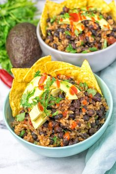 This Vegetarian BBQ Burrito Bowl is full of black beans, spicy garlic, and amazing flavors. It is super easy to make, vegan, gluten free.