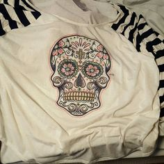 Sugar Skull Shirt WAS NOT SOLD Cute sugar skull cream colored shirt with navy blue stripes brand new with tags. 26/28. ?? ?? Make a reasonable Offer ?? ?? Lane Bryant Tops Tees - Long Sleeve