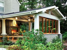 """This garden room is a Northwest take on the lanai. It's open on two sided and provides flexible options for outdoor living. The architect conceived it as a summer deck that would """"float"""" in a sea of salal, but it was transformed into an all-season outdoor room when he and the owners decided to add a roof, a fireplace, and walls that slide closed in stormy weather."""