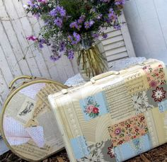 Old luggage dolled up with paper and paint.