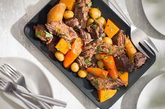 Loaded with root veggies, this hearty pot roast dinner is an old-fashioned comforting one-pot dinner that never goes out of style. Slow Cooker Times, Slow Cooker Recipes, Crockpot Recipes, Fall Recipes, Great Recipes, Dinner Recipes, Yummy Recipes, Root Veggies, Roast Dinner