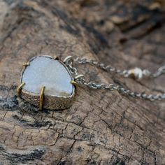 White teardrop shaped druzy pendant necklace with silver and brass setting and oxidized silver chain Check more at