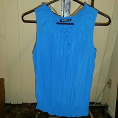 A.N.A Top NWOT!!! This was given to me as a gift, but it's just not my style. It's a beautiful blue and very soft. It's 100% Rayon. a.n.a Tops Blouses