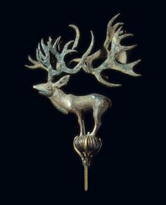 Terminal: Stag on a Ball. Place: Russia. Epoch. Period: Early Iron Age. Date: Pazyryk Culture. 5th century BC. Place of finding: Pazyryk Barrow No. 2 (excavations by S.I. Rudenko). Archaeological site: Altai Territory, Pazyryk Boundary, the Valley of the River Bolshoy Ulagan. Material: wood and leather.