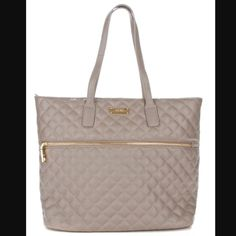 "NWT BCBG Purse NWT BCBG Paris quilted taupe tote. Has front and inside zip compartment with two pockets inside. Measures: 12""H X 14""W with a 9"" strap drop. BCBG Bags Totes"