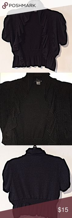 💕NWOT! Black Glitter Crop Jacket💕 NWOT! Black ruffled crop top with silver glitter. Has elastic around edges and waist. Rouched short sleeves. Made from Polyester, Rayon, Nylon, and Spandex. Can be dressed up or down, Perfect for layering! XXI Tops