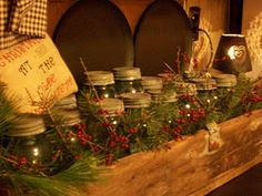 ** SIMPLY CHRISTMAS ~ Mason Jars and greenery . Use this idea above sink serving window, using some of the other rustic kitchen stuff in the arrangement. Primitive Christmas Decorating, Country Christmas Decorations, Prim Christmas, Christmas Past, All Things Christmas, Vintage Christmas, Christmas Holidays, Primitive Crafts, Christmas Ideas