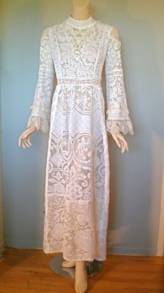 http://www.etsy.com/listing/94688415/beaded-sheer-vintage-crochet-lace-maxi
