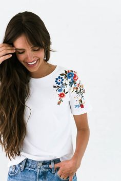 "DETAILS: Floral embroidery on shoulder Fabric content: 95% Cotton 5% Elastane Model is wearing size Small MEASUREMENTS: Bust: S= 35"",..."