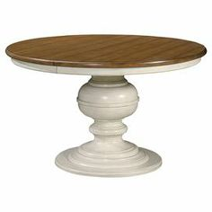 """Extendable round dining table with one leaf and a turned pedestal base.  Product: Dining tableConstruction Material: Maple veneers and select hardwood solidsColor: CottonFeatures:  One 20"""" Leaf Adjustable levelers Dimensions: 30 H x 50"""" Diameter"""