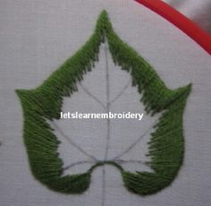 In my previous post, I'd already shown you on how I embroidered a leaf following the long and short stitch direction     rules.Today, ...
