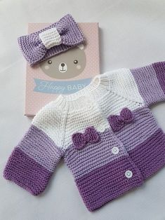 Cardigan and bow for baby worked in garter stitch, using shades of purple. - - Cardigan and bow for baby worked in garter stitch, using shades of purple. – Cardigan and bow for baby worked in garter stitch, using shades of purple. Crochet Jacket Pattern, Baby Cardigan Knitting Pattern, Baby Knitting Patterns, Baby Patterns, Knitting Sweaters, Crochet Cardigan, Crochet Patterns, Knit Baby Sweaters, Baby Knits