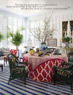 A blue and white striped Dhurrie rug contrasts with a red and white damask table cloth and dark green wicker chairs in the dining room of a Southern Gothic cottage restored by Furlow Gatewood. Cottage Design, House Design, Southern Cottage, Southern Gothic, Southern Charm, Southern Style, South Shore Decorating, Gothic House, White Rooms