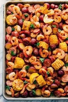 seafood recipes In all things simple, delicious, and mouth watering this Sheet Pan Garlic Shrimp Broil is going to do the trick. Loaded with jumbo shrimp, red potatoes, thick pieces of sausage and corn all dipped in a Creamy Chipotle Sauce. Seafood Boil Party, Shrimp Boil Foil, Seafood Boil Recipes, Garlic Shrimp, Seafood Dishes, Seafood Bake, Crab Boil, Shrimp Boil In Oven, Shrimp Bake