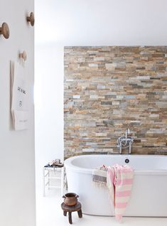Bring stone to the walls in your bath. Get it in your house some how.Bath with stone wall Bad Inspiration, Bathroom Inspiration, Bathroom Interior, Modern Bathroom, White Bathroom, Stone Bathroom, Bathroom Wall, Design Bathroom, Natural Bathroom
