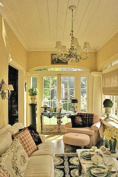 beautiful enclosed porch. Love the light and airy feel of this room. beautiful enclosed porch. Love the light and airy