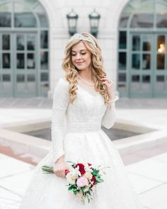 This ivory silver checkered gown was made even more gorgeous by adding elegant sleeves and creating a modest buildup for a temple wedding.  . Photo: @kendrabirdphotography Venue: @thegrandamerica Dress: Custom Lazaro style 3814 . . #BitsyBride #lazaroweddingdress #modestweddingdress #customballgown #coturegown