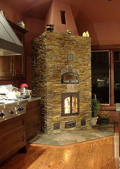 I would love to have a fireplace oven in the kitchen.
