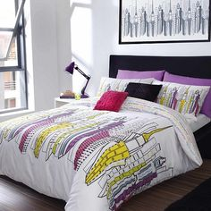 Bring a modern look to your bedroom with this large scaled cityscape design. Available in a vivid colour palette, the bed linen is complemented with a selection of cushions in both black and Zandra's signature pink