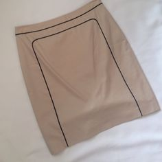 "Ann Taylor Tan with Black Piping Skirt Perfect condition.  Tan with black piping detail on front and back, fully lined, side zip, back 6"" slit.  Approx measurements laying flat: waist 15.5"", hips 18"", length 20"". Ann Taylor Skirts"
