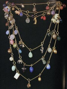 A very fun, multi-colored Faberge pendant necklace with small animals and egg charms.