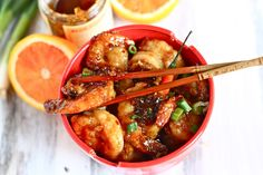 Orange Peel Shrimp  2 lbs raw shrimp, deveined with tails on or off  4 cloves garlic, minced  8 scallions, finely chopped  2 oranges, zested and juiced  6 tbsp orange marmalade  ½ cup soy sauce  4 Thai chili peppers (optional but recommended)  ¼ tsp red pepper flakes  ¼ cup cornstarch  4 tbsp canola oil, divided  1 cup brown rice, cooked and fluffed with a fork