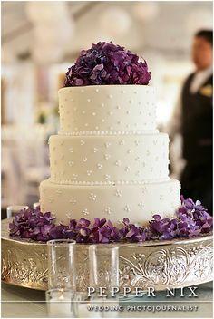 white wedding cake with purple hydrangea by Stein Eriksen Lodge
