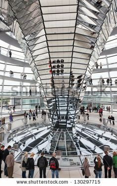 BERLIN, GERMANY - SEP. 24:Tourists under  Reichstag dome, September 24, 2012, Berlin, Germany. After moving of Bundestag to Berlin in 1999  building of  Reichstag was visited by over 13 mill. people - stock photo