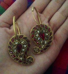 Kundan Earrings #paisley #ambi set in diamonds and rubies from Amrapali
