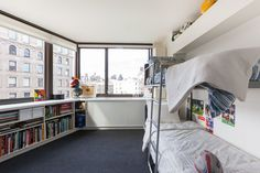 The boys room maximizes space with the Lollisoft bunk beds by Resource Furniture .                                 Shelving system by Rakks