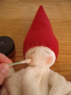 DIY Waldorf inspired washcloth gnome doll. For the teething baby.