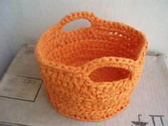 Nice crocheted basket from old material. Directions in Spanish, but I think I got the gist of it. Crochet terms were NOT covered in high school Spanish class 40+ years ago!
