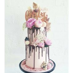"""""""2015 was the year of the buttercream cake! Some with chocolate drip, some with macarons or just dressed nicely with fresh blooms!!! . Forty topper by…"""""""