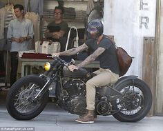 David Beckham on a vintage motorcycle.