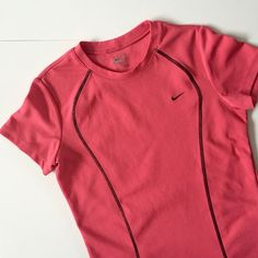 "Nike Performance Tee Bubble gum pink colored Nike Performance top. 100% polyester. About 22"" long and about 17 1/2"" pit to pit. Used but still in good condition! No holes, rips, or stains. NO TRADES. Nike Tops"