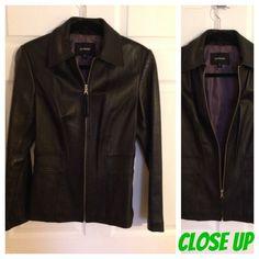 Like new Express Black Leather Jacket size 10 Barely worn genuine leather black leather jacket by express. Plum nylon lining. Size 10 pet/smoke free Express Jackets & Coats