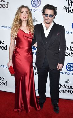 Amber Heard & Johnny Depp from 2016 Golden Globes: Party Pics  The married couple attends theArt of Elysium 2016 HEAVEN Gala, presented by Vivienne Westwood & Andreas Kronthaler, at 3LABS in Culver City, California.