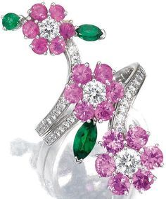 Gem-set and diamond ring, Van Cleef & Arpels. Designed as three flowers set with circular-cut pink sapphires, pear- and marquise-shaped garnets, highlighted with brilliant-cut diamonds, mounted in white gold, size 56, signed Van Cleef & Arpels and numbered, French assay and partial maker's marks, accompanied by fitted case signed Van Cleef & Arpels. Sotheby's.