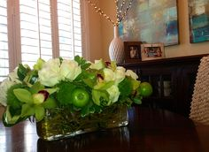 Perfect flower arrangement rises & apples, & moss. Wish you could smell it. Mmmm . Mark from a Fort Lauderdale florist made for me http://flowersandfoundobjects.com/