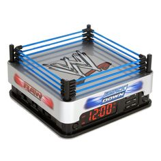 WWE Ring alarm clock - This has to be by far the coolest themed alarm clock I've seen. It's one thing to stick a picture on a normal wall clock or alarm clock. It's another to come up with such a clever application of an element.  Click through for more WWE decor ideas (including normal clocks).