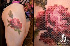 That's a cross stitched tattoo done right. credit to the artist:  Julie Hamilton • Art et Tatouage / Art & Tattoo - imgur.com