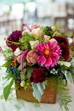mixed floral arrangement in a wooden box - love the deep colors