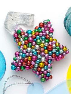 Add dazzle to your #Christmas #tree with this piece made from dozens of colorful pearls. #holiday #decor
