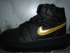 reputable site 78d26 cd8e2 Kids Air Jordan 1 Black Metallic Gold