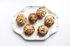 May I introduce you to these gently spiced muffins? inside, you'll find soft, joyous chunks of apple throughout, and a buttery pebble-like streusel on top makes