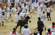 One of the bulls tosses a runner during the Running of the Bulls in Pamplona, Spain, on Wednesday, June The dangerous tradition has tallied thousands of injuries and 15 deaths since record-keeping began in including the fatal goring of a Spanish man in Running Of The Bulls, Spanish Men, Pamplona Spain, Wednesday, Gypsy, June, Photography, Curves, Sevilla Spain