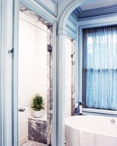Tour a Gorgeously Layered Boston Townhouse// blue and marble master bathroom Interior Design Masters, Bathroom Interior Design, Boston Brownstone, Laundry In Bathroom, Master Bathroom, Sheer Drapes, Bathroom Pictures, Beautiful Bathrooms, Bathroom Inspiration